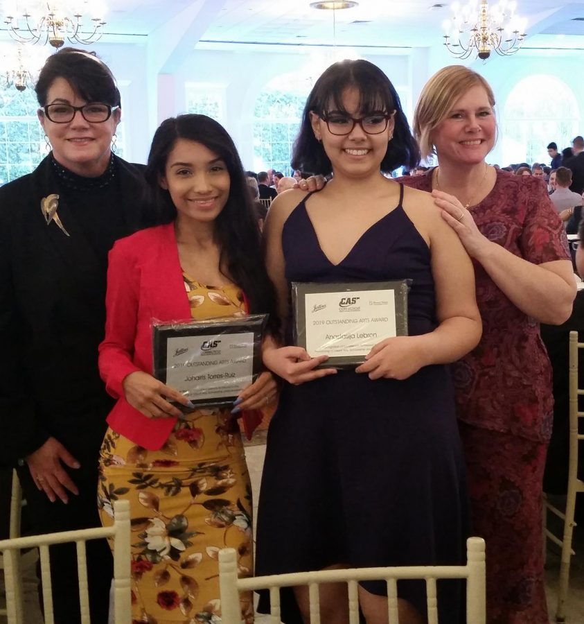 Wilby students Johairis Torres, left, and Anastasija Lebron stand with teachers Miss Pulit and Miss Doolan at the celebration Tuesday night. Contributed photo