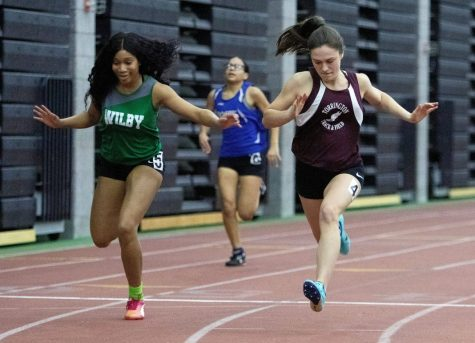 Kayla Tyson of Wilby finishes the 55-meter dash during the NVL championship Monday. Photo courtesy of Steven Valenti of the Republican-American