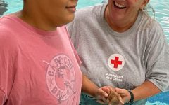Miss Lori Stroud, head of the PE department at Wilby HIgh School, works with a visually impaired student recently in the pool. Miss Stroud said the student had a blast in the pool. Contributed photo